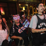 Fans react at the San Antonio Spurs fall to the Miami Heat in Game 6 of the NBA Finals basketball game, Tuesday, June 18, 2013, in San Antonio. Miami won in overtime 103-100.  (AP Photo/Eric …