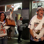 Miami Heat fans celebrate after  winning Game 6 in the NBA Finals against the San Antonio Spurs at the in Miami, on Tuesday, June 18, 2013.(AP Photo/Javier Galeano)