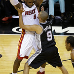 San Antonio Spurs point guard Tony Parker (9) defends Miami Heat small forward LeBron James (6) during the second half of Game 6 of the NBA Finals basketball game, Tuesday, June 18, 2013 in  …