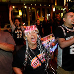 Fans cheer for the San Antonio Spurs as they fall to the Miami Heat in Game 6 of the NBA Finals basketball game, Tuesday, June 18, 2013, in San Antonio. Miami won in overtime 103-100.  (AP P …