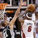 Miami Heat small forward LeBron James (6) shoots against San Antonio Spurs power forward Tim Duncan (21) during the second half of Game 6 of the NBA Finals basketball game, Tuesday, June 18, …