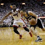 San Antonio Spurs shooting guard Manu Ginobili (20) of Argentina drives the ball as Miami Heat shooting guard Dwyane Wade (3) during overtime of Game 6 of the NBA Finals basketball game, Wed …