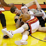 San Antonio Spurs center Tiago Splitter (22) of Brazil and Miami Heat power forward Chris Andersen (11) vie for a loose ball during the first half of Game 6 of the NBA Finals basketball game …