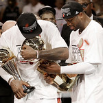 The Miami Heat's Dwyane Wade, right, holds the Larry O'Brien NBA Championship Trophy with  LeBron James holding his Bill Russell NBA Finals Most Valuable Player Award after Game 7 of the NBA …