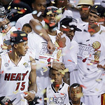 Miami Heat players including LeBron James, top center, celebrate after Game 7 of the NBA basketball championship game against the San Antonio Spurs, Friday, June 21, 2013, in Miami. The Miam …