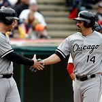 Chicago White Sox's Paul Konerko (14) is greeted by Adam Dunn after Konerko's two-run home run off Cleveland Indians starting pitcher Brett Myers in the sixth inning of an MLB baseball game  …