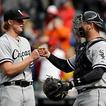 Chicago White Sox relief pitcher Addison Reed, left, is congratulated by catcher Tyler Flowers after Reed saved a 3-1 win over the Cleveland Indians in a baseball game Sunday April 14, 2013, …