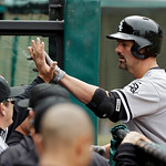Chicago White Sox's Paul Konerko is welcomed to the dugout after a two-run home run in the sixth inning of an MLB baseball game against the Cleveland Indians Sunday, April 14, 2013, in Cleve …