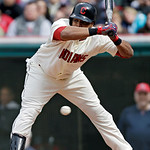 Cleveland Indians' Carlos Santana backs away from an inside pitch from Chicago White Sox relief pitcher Addison Reed in the ninth inning of a baseball game on Sunday, April 14, 2013, in Clev …