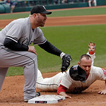 Cleveland Indians' Ryan Raburn, right, is tagged out by Chicago White Sox first baseman Adam Dunn on a pickoff throw from starting pitcher Jake Peavy in the fifth inning of a baseball game o …