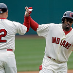 Cleveland Indians' Michael Bourn, right, celebrates his solo home run off Chicago White Sox starting pitcher Jake Peavy with third base coach Brad Mills (2) in the first inning of a baseball …