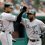 Chicago White Sox's Alejandro De Aza (30) is welcomed by Alex Rios (51) after De Aza's solo home run off Cleveland Indians relief pitcher Vinnie Pestano in the eighth inning of a baseball ga …