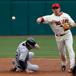 Cleveland Indians shortstop Asdrubal Cabrera throws over Chicago White Sox's Conor Gillaspie (12) but can't complete a double play on Alexei Ramirez in the third inning of a baseball game Su …