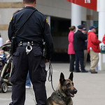 A Cleveland police K-9 unit patrols inside a gate at Progressive Field before a baseball game between the Boston Red Sox and Cleveland Indians Tuesday, April 16, 2013, in Cleveland. (AP Phot …