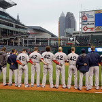 The Boston Red Sox players and coaches observe a moment of silence for the victims of the Boston bombings before a baseball game  against the Cleveland Indians Tuesday, April 16, 2013, in Cl …