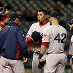 Boston Red Sox starting pitcher Felix Doubront, center, gets a visit from pitching coach Juan Nieves in the fifth inning of a baseball game against the Cleveland Indians Tuesday, April 16, 2 …