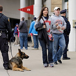 Fans walk past a Cleveland Police K-9 unit at Progressive Field before a baseball game between the Boston Red Sox and Cleveland Indians Tuesday, April 16, 2013, in Cleveland. (AP Photo/Mark  …