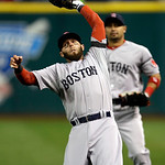 Boston Red Sox second baseman Dustin Pedroia catches a popup by Cleveland Indians' Mark Reynolds to end the fifth inning of a baseball game Tuesday, April 16, 2013, in Cleveland. (AP Photo/M …