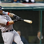 Boston Red Sox's Mike Napoli hits a bases-loaded double off Cleveland Indians starting pitcher Ubaldo Jimenez to drive in three runs in the second inning of a baseball game Tuesday, April 16 …