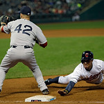 Cleveland Indians' Michael Brantley, right, dives back into first on a pickopp attempt in the sixth inning of a baseball game against the Boston Red Sox Tuesday, April 16, 2013, in Cleveland …