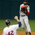 Boston Red Sox third baseman Pedro Ciriaco fires over Cleveland Indians' Mark Reynolds to complete a double play in the eighth inning of a baseball game Tuesday, April 16, 2013, in Cleveland …