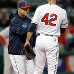 Cleveland Indians manager Terry Francona, left, takes starting pitcher Ubaldo Jimenez out of a baseball game against the Boston Red Sox in the second inning Tuesday, April 16, 2013, in Cleve …