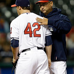 Cleveland Indians manager Terry Francona, right, pats relief pitcher Cody Allen on the back as he leaves a baseball game against the Boston Red Sox in the fifth inning Tuesday, April 16, 201 …