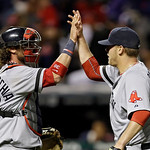Boston Red Sox catcher Jarrod Saltalamacchia, left, celebrates with relief pitcher Andrew Bailey after a 6-3 win over the Cleveland Indians in a baseball game Wednesday, April 17, 2013, in C …