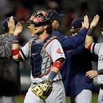 Boston Red Sox catcher Jarrod Saltalamacchia, center, celebrates with teammates after a 6-3 win over the Cleveland Indians in a baseball game Wednesday, April 17, 2013, in Cleveland. (AP Pho …