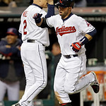 Cleveland Indians' Nick Swisher, right, celebrates his two-run home run with third base coach Brad Mills (2) in the sixth ining of a baseball game against the Boston Red Sox Wednesday, April …