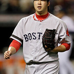 Boston Red Sox relief pitcher Junichi Tazawa comes off the field after ending the sixth inning of a baseball game against the Cleveland Indians Wednesday, April 17, 2013, in Cleveland. (AP P …