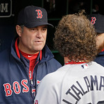 Boston Red Sox manager John Farrell talks with catcher Jarrod Saltalamacchia before a baseball game against the Cleveland Indians Wednesday, April 17, 2013, in Cleveland. (AP Photo/Mark Dunc …