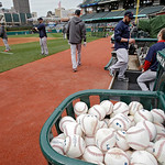 Boston Red Sox players warm up before a baseball game against the Cleveland Indians Wednesday, April 17, 2013, in Cleveland. (AP Photo/Mark Duncan)