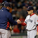 Boston Red Sox starting pitcher Alfredo Aceves hands the ball to manager John Farrell in the sixth inning of a baseball game against the Cleveland Indians Wednesday, April 17, 2013, in Cleve …