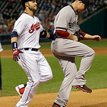 Cleveland Indians' Nick Swisher, left, is out at first with Boston Red Sox starting pitcher Jon Lester covering in the fourth inning of a baseball game Thursday, April 18, 2013, in Cleveland …