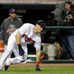 Cleveland Indians' Asdrubal Cabrera slips rounding third on a double by Carlos Santana in the eighth inning of a baseball game against the Boston Red Sox Thursday, April 18, 2013, in Clevela …