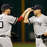 Boston Red Sox relief pitcher Andrew Bailey (40) celebrates with center fielder Jacoby Ellsbury after a 6-3 win over the Cleveland Indians in a baseball game on Thursday, April 18, 2013, in  …