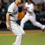 Boston Red Sox relief pitcher Koji Uehara reacts after giving up a double to Cleveland Indians' Carlos Santana to drive in a run in the eighth inning of a baseball game on Thursday, April 18 …