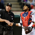 Cleveland Indians catcher Carlos Santana gets a new ball from home plate umpire Mike Winters in the third inning of a baseball game against the Boston Red Sox Thursday, April 18, 2013, in Cl …