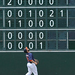 Houston Astros' Fernando Martinez watches the ball go over the left field wall for a solo homer for Cleveland Indians' Carlos Santana in the fifth inning of a baseball game Sunday, April 21, …