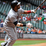 Cleveland Indians' Carlos Santana watches the ball in the first inning of a baseball game against the Houston Astros Sunday, April 21, 2013, in Houston. (AP Photo/Pat Sullivan)