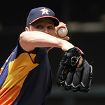 Houston Astros' Erik Bedard delivers a pitch against the Cleveland Indians in the first inning of a baseball game on Sunday, April 21, 2013, in Houston. (AP Photo/Pat Sullivan)