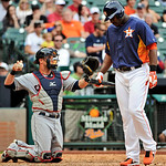 Houston Astros' Chris Carter, right, hangs his head after striking out with the bases loaded as Cleveland Indians catcher Yan Gomes throws the ball back to the plate in the ninth inning of a …