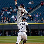 Cleveland Indians' Mark Reynolds (12) is unable to catch a high throw from second baseman Jason Kipnis, not shown, as Chicago White Sox's Jeff Keppinger advances to second on the throwing er …