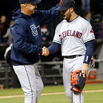Cleveland Indians manager Terry Francona, left, celebrates with right fielder Nick Swisher after their 3-2 win over the Chicago White Sox in a baseball game, Monday, April 22, 2013, in Chica …