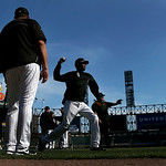 Chicago White Sox shortstop Alexei Ramirez, center, warms up for batting and fielding practice before a baseball game against the Cleveland Indians Monday, April 22, 2013, in Chicago. (AP Ph …