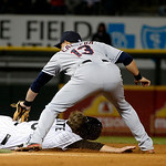 Cleveland Indians shortstop Asdrubal Cabrera (13) takes a throw from catcher Carlos Santana and picks off Chicago White Sox's pinch runner Blake Tekotte  during the seventh inning of a baseb …
