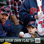 Rob Janosek, left, and his four-year-old son Luke, from Montgomery, Ill., wait by the Cleveland Indians' dugout for an autograph before a baseball game between the Chicago White Sox and the  …