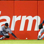 Cleveland Indians left fielder Michael Brantley, left, is unable to catch an RBI double by Chicago White Sox's Hector Gimenez, scoring Alexei Ramirez, as center fielder Drew Stubbs comes ove …