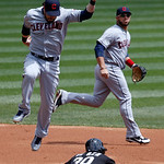 Chicago White Sox's Alejandro De Aza (30) steals second as Cleveland Indians second baseman Jason Kipnis catches a high throw from Lou Marson, as shortstop Mike Aviles watches, during the fi …